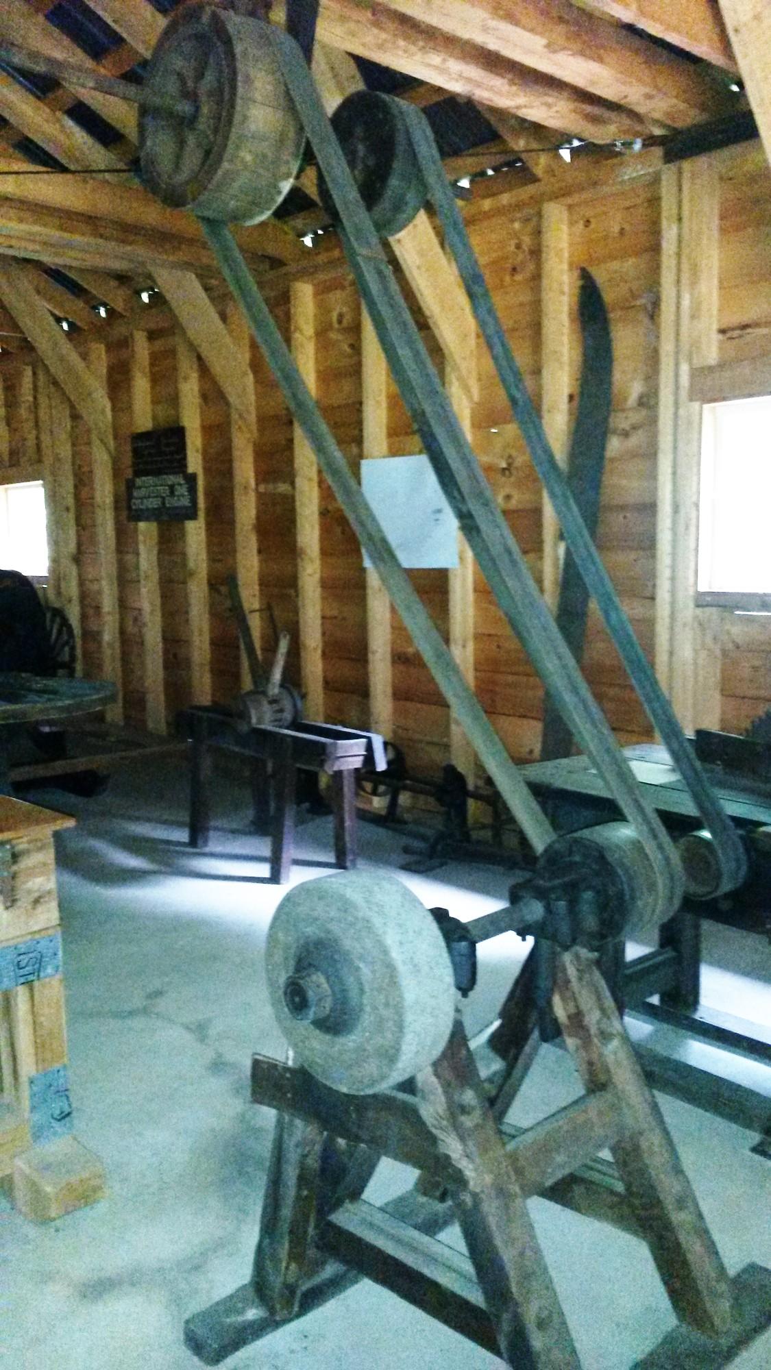 Belt-powered wheelwright workshop at Woodsmen's museum