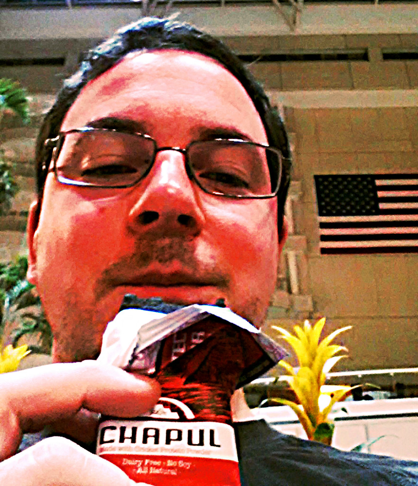 Eating a Chapul Aztec bar in MCO