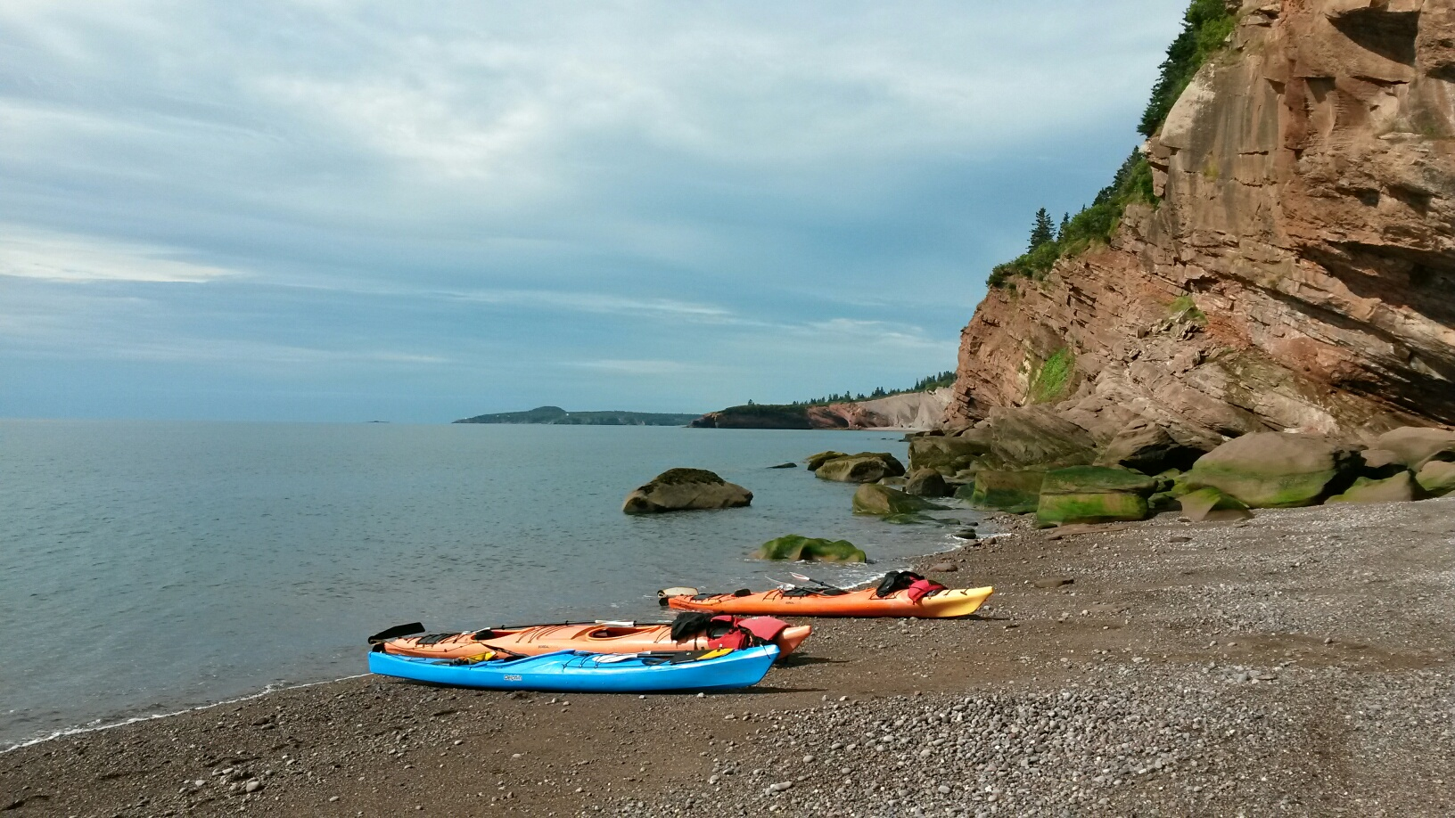Sandstone cliffs and sea kayaks